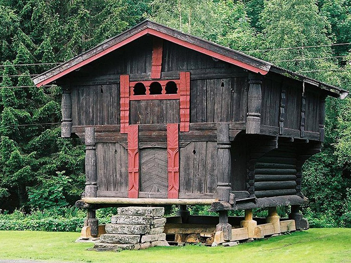 historic two story log structure on raised footings