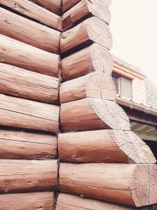 wooden logs stacked horizontally