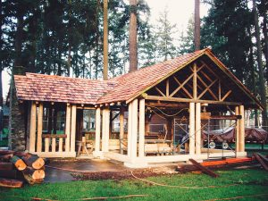Right view of the log construction covered picnic area in park forest area