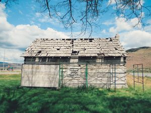 rear view of the old, log cabin Skolaskin Church