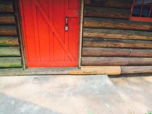 Log cabin with a red door