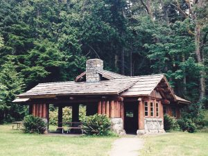 the log cabin covered picnic area in the park