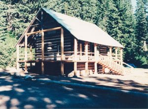 two story log construction in park forest area