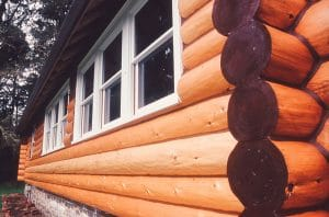 renovated and painted log wall with windows