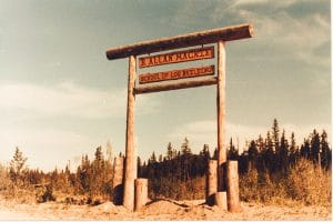 B. Allan Mackie - School of log building sign